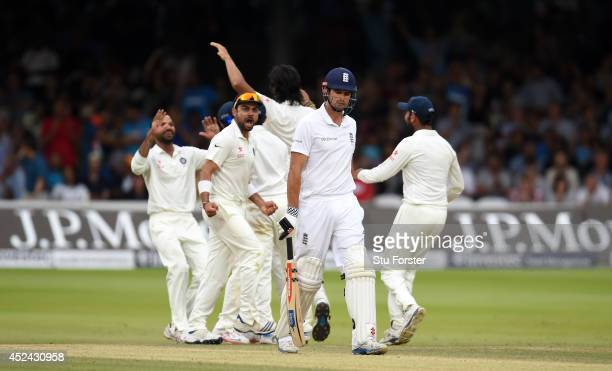 England batsman Alastair Cook leaves the crease after being dismissed as the India fielders celebrate during day four of 2nd Investec Test match...
