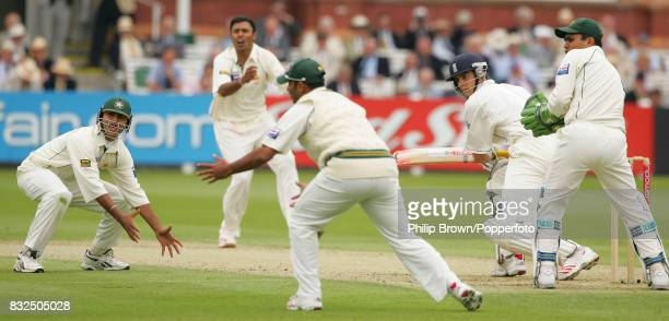 England batsman Alastair Cook plays a shot through the close fielders off the bowling of Pakistan's Danish Kaneria during his innings of 105 in the...