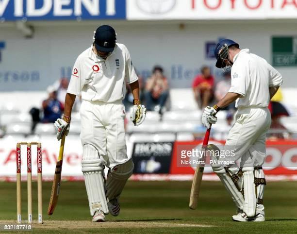 England batsman Alastair Cook walks off dejected after losing his wicket to Pakistan spinner Danish Kaneria for 21 runs during the fourth day of the...