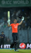 England batsman Alex Hales celebrates his century during the ICC World Twenty20 tournament cricket match between England and Sri Lanka at The Zahur...