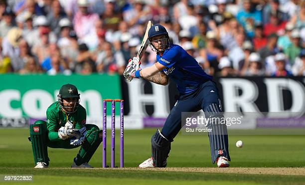 England batsman Alex Hales hits a ball for 6 runs watched by wicketkeeper Sarfraz Ahmed during the 3rd One Day International between England and...