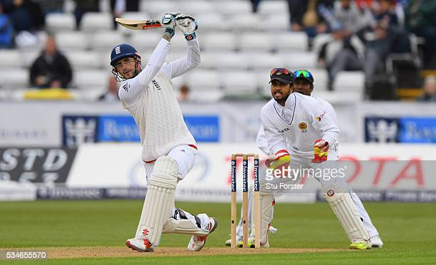 England batsman Alex Hales reaches his half century with a shot over mid on during day one of the 2nd Investec Test match between England and Sri...