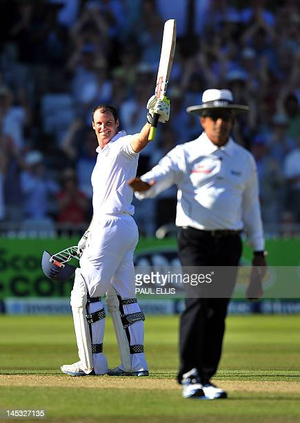 England batsman Andrew Strauss celebrates after hitting a four to reach 100 not out on the second day of the second Test match between England and...