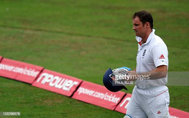 England batsman Andrew Strauss leaves the field after being caught by wicket keeper Zulqarnain Haider off the bowling of Mohammad Amir for 25 runs on...