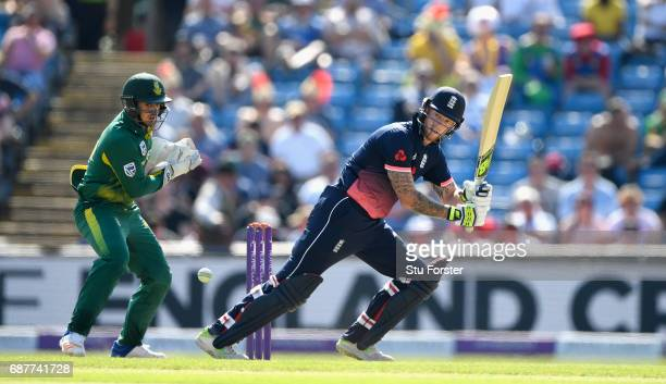 England batsman Ben Stokes hits out watched by South Africa wicketkeeper Quinton de Kock during the 1st Royal London One Day International match...