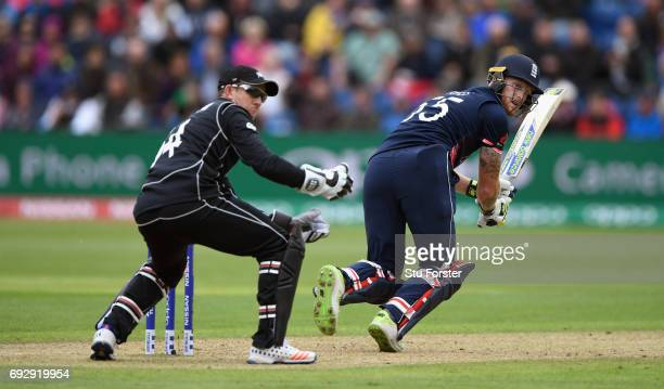 England batsman Ben Stokes hits out watched by wicketkeeper Luke Ronchi during the ICC Champions Trophy match between England and New Zealand at...