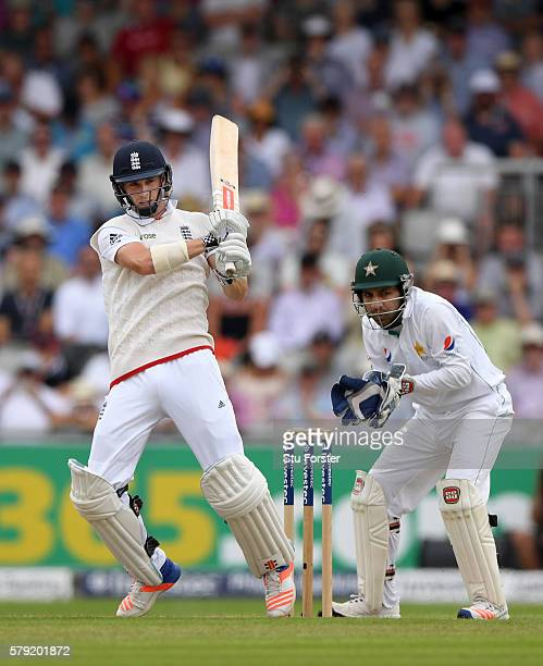 England batsman Chris Woakes hits out watched by Sarfraz Ahmed during day two of the 2nd Investec Test match between England and Pakistan at Old...