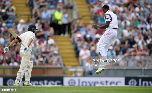 England batsman Dawid Malan is dimissed by a celebrating West Indies bowler Jason Holder during day one of the 2nd Investec Test match between...