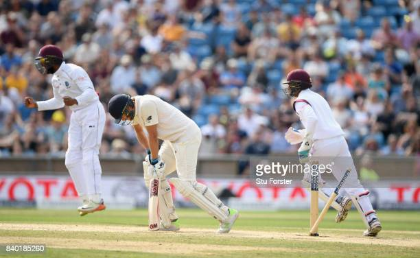 England batsman Dawid Malan reacts after being bowled by Chase during day four of the 2nd Investec Test Match between England and West Indies at...