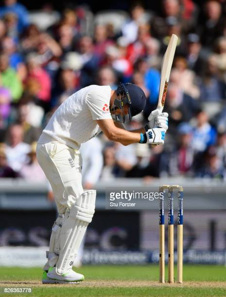 England batsman Dawid Malan reacts after being caught behind during day one of the 4th Investec Test match between England and South Africa at Old...