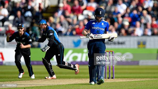 England batsman Eoin Morgan leaves the field after being dismissed first ball as wicketkeeper Luke Ronchi celebrates during the 5th Royal London One...