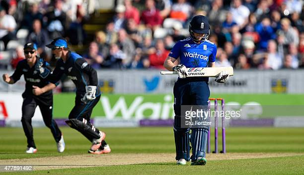 England batsman Eoin Morgan leaves the field after being dismissed first ball as wicketkeeper Luke Ronchi and Kane Wwilliamson celebrate during the...