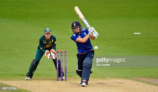 England batsman Heather Knight hits out as Australia keeper Alyssa Healy looks on during the 3rd Royal London ODI of the Women's Ashes Series between...