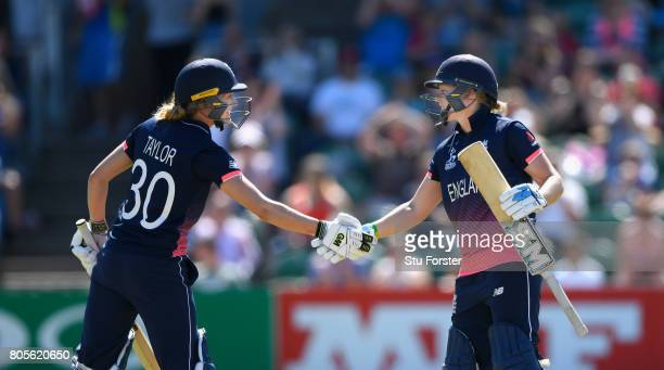 England batsman Heather Knight is congratulated on her half century by Sarah Taylor during the ICC Women's World Cup 2017 match between England and...