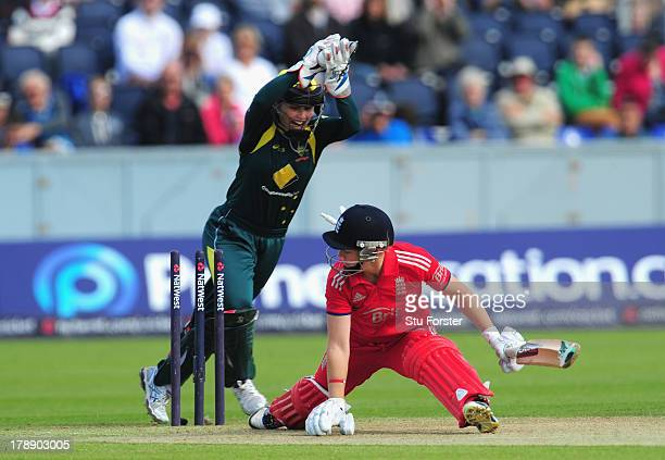 England batsman Heather Knight is stumped by Australia wicketkeeper Jodie Fields during the Women's Ashes Series 3rd NatWest T20 between England...