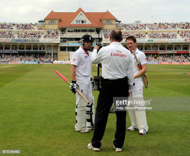England batsman Ian Bell and Eoin Morgan speak to umpire Tim Robinson while a decision on a run out of Bell is decided during the 2nd Test match at...