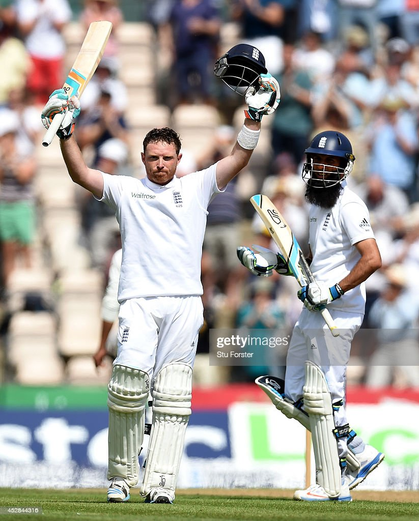 England batsman Ian Bell celebrates his century as Moeen Ali applauds during day two of the 3rd Investec Test at Ageas Bowl on July 28, 2014 in Southampton, England.