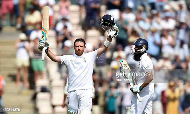 England batsman Ian Bell celebrates his century as Moeen Ali applauds during day two of the 3rd Investec Test at Ageas Bowl on July 28 2014 in...