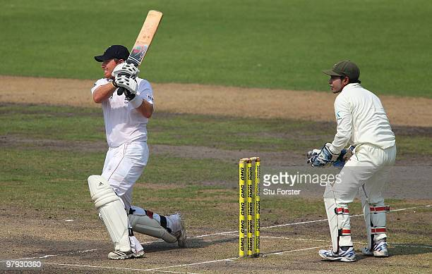 England batsman Ian Bell hits a ball to the boundary watched by wicketkeeper Mushfiqur Rahim during day three of the 2nd Test match between...