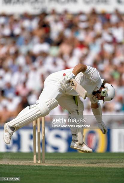 England batsman Ian Botham loses his balance after attempting to hook a short ball from Curtley Ambrose and is out hit wicket for 31 in the first...