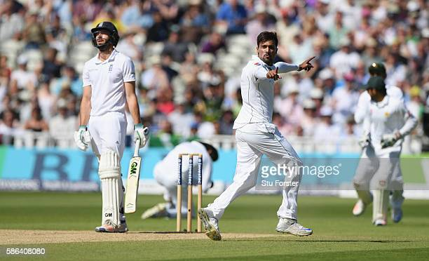 England batsman James Vince reacts as Mohammad Amir celebrates after Vince had been caught at slip by Younis Khan during day 4 of the 3rd Investec...