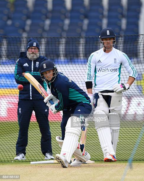 England batsman Joe Root faces whilst team mate Nick Compton and former England batsman Graeme Fowler look on during England Nets session ahead of...