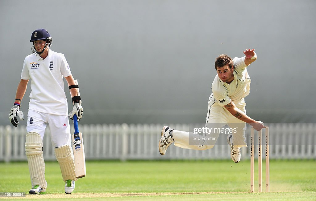 England batsman <a gi-track='captionPersonalityLinkClicked' href=/galleries/search?phrase=Joe+Root&family=editorial&specificpeople=6688996 ng-click='$event.stopPropagation()'>Joe Root</a> looks on as New Zealand bowler <a gi-track='captionPersonalityLinkClicked' href=/galleries/search?phrase=Doug+Bracewell&family=editorial&specificpeople=6680321 ng-click='$event.stopPropagation()'>Doug Bracewell</a> delivers during day two of the tour match between England Lions and New Zealand at Grace Road on May 10, 2013 in Leicester, England.
