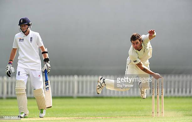 England batsman Joe Root looks on as New Zealand bowler Doug Bracewell delivers during day two of the tour match between England Lions and New...
