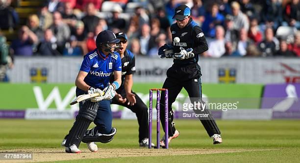 England batsman Joe Root looks on as wicketkeeper Luke Ronchi prepares to stump him during the 5th Royal London One day international between England...