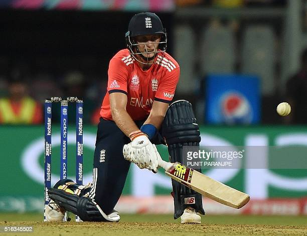 England batsman Joe Root plays a shot during the World T20 cricket tournament match between England and South Africa at The Wankhede Stadium in...