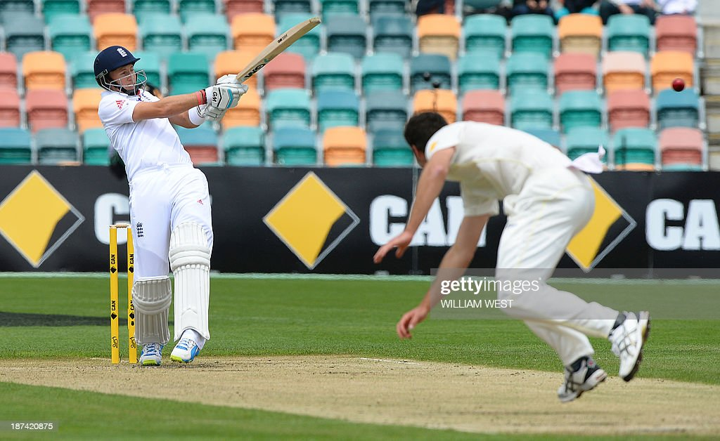 England batsman Joe Root (L) pulls a delivery from the Australia A paceman Ben Cutting (R) on the final day of their cricket match played at the Bellerive Oval in Hobart on November 9, 2013. AFP PHOTO/William WEST IMAGE