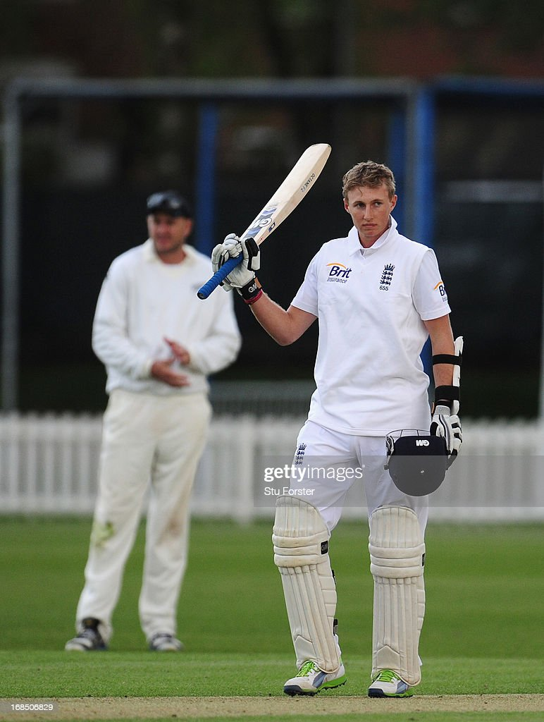 England batsman <a gi-track='captionPersonalityLinkClicked' href=/galleries/search?phrase=Joe+Root&family=editorial&specificpeople=6688996 ng-click='$event.stopPropagation()'>Joe Root</a> raises his bat after reaching his century during day two of the tour match between England Lions and New Zealand at Grace Road on May 10, 2013 in Leicester, England.