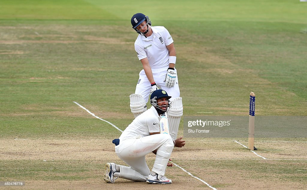 England batsman <a gi-track='captionPersonalityLinkClicked' href=/galleries/search?phrase=Joe+Root&family=editorial&specificpeople=6688996 ng-click='$event.stopPropagation()'>Joe Root</a> reacts after being caught as Indian fielder <a gi-track='captionPersonalityLinkClicked' href=/galleries/search?phrase=Cheteshwar+Pujara&family=editorial&specificpeople=815522 ng-click='$event.stopPropagation()'>Cheteshwar Pujara</a> celebrates during day five of 2nd Investec Test match between England and India at Lord's Cricket Ground on July 21, 2014 in London, United Kingdom.