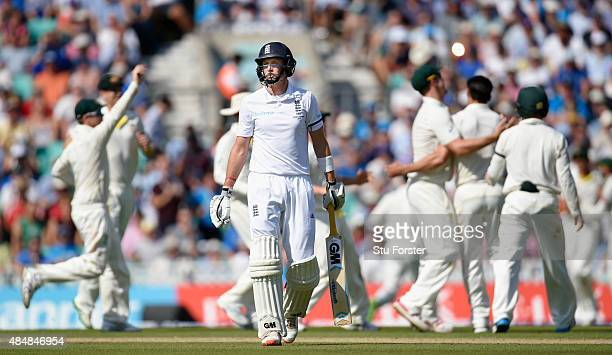 England batsman Joe Root reacts after being dismissed during day three of the 5th Investec Ashes Test match between England and Australia at The Kia...