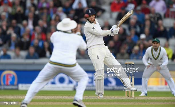England batsman Jonathan Bairstow hits the ball past fielder Hashim Amla during day three of the 4th Investec Test Match between England and South...