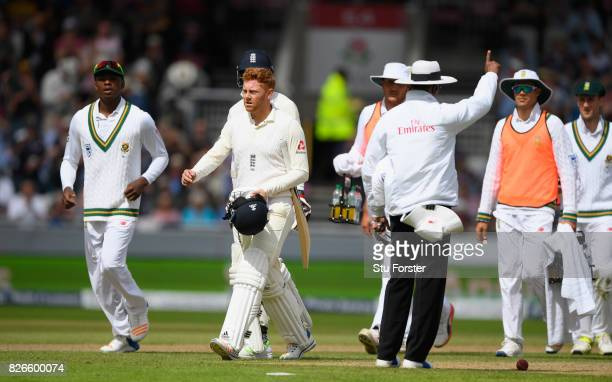 England batsman Jonathan Bairstow leaves the field as the umpire gives him out for 99 runs after review during day two of the 4th Investec Test match...