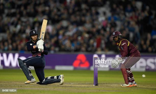 England batsman Jonathan Bairstow sweeps a ball towards the boundary watched by wicketkeeper Shai Hope during the 1st Royal London One Day...