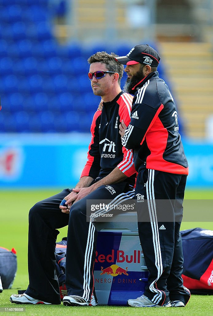 England batsman Kevin Pietersen gets a loving arm put round him by spinning coach Mushtaq Ahmed during the England nets session at the Swalec Stadium...