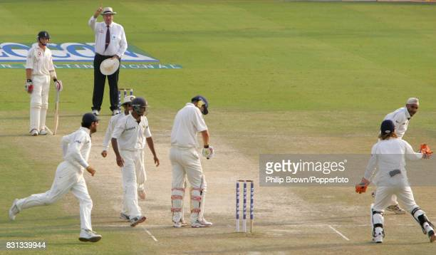 England batsman Kevin Pietersen looks at his arm after being given out by umpire Darrell Hair caught behind by India's Rahul Dravid off the bowling...