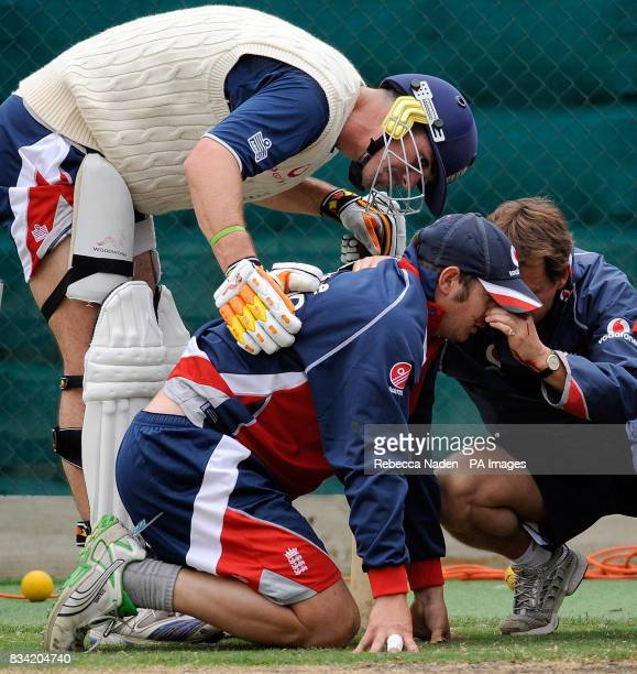 England batsman Kevin Pietersen with Phil Mustard who receives attention for a bleeding nose after being hit in the face by a cricket ball during net...