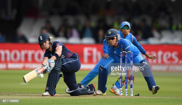 England batsman Laura Winfield sweeps a ball to the boundary watched by wicketkeeper Sushma Verma during the ICC Women's World Cup 2017 Final between...
