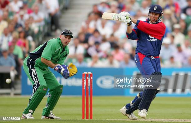 England batsman Marcus Trescothick hits a four during his innings of 113 runs watched by Ireland wicketkeeper Jeremy Bray during the only One Day...