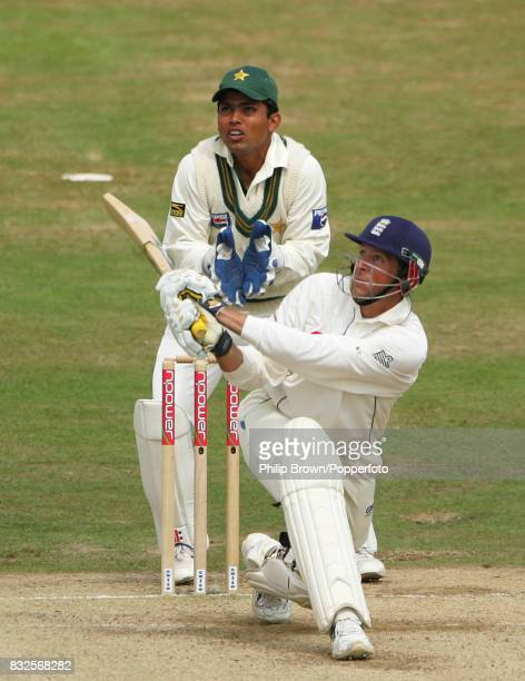 England batsman Marcus Trescothick hits a four during his innings of 58 runs watched by Pakistan wicketkeeper Kamran Akmal in the 3rd Test match...