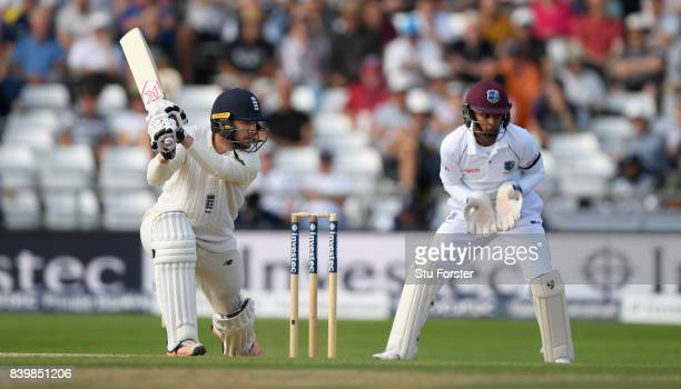 England batsman Mark Stoneman cuts a ball to towards the boundary watched by Shane Dowrich during day three of the 2nd Investec Test match between...