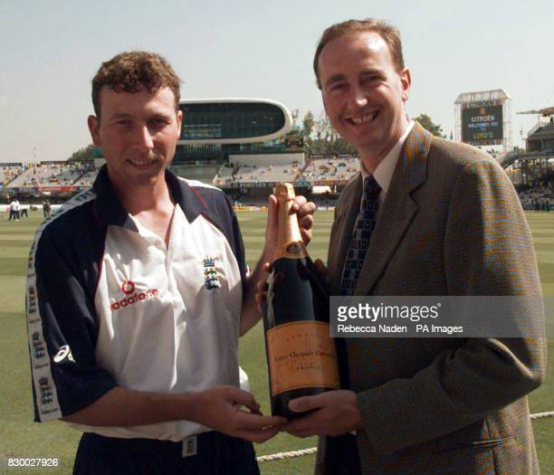 England batsman Michael Atherton receives a magnum of champagne on the pitch at Lords today from BBC commentator Johnathan Agnew for winning the Test...