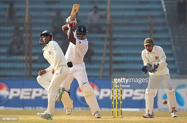 England batsman Michael Carberry cuts a ball to the boundary watched by Bangladesh wicketkeeper Mushfiqur Rahim during day three of the 1st Test...