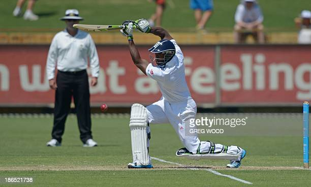England batsman Michael Carberry drives the ball to the boundary for four runs on day two of the Ashes tour match against a Western Australian...