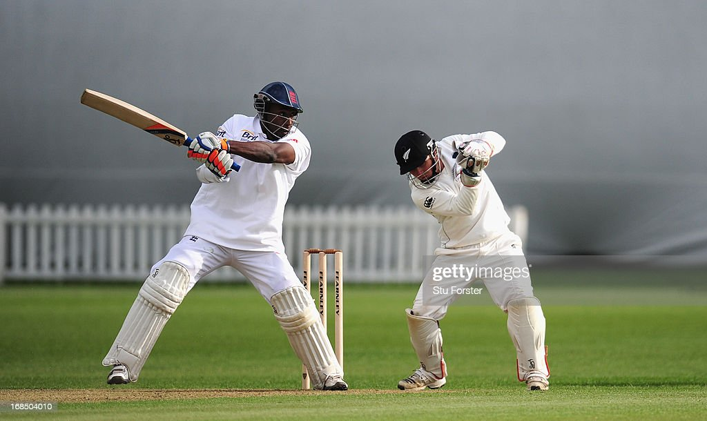 England batsman Michael Carberry hits to the boundary watched by keeper BJ Watling during day two of the tour match between England Lions and New Zealand at Grace Road on May 10, 2013 in Leicester, England.