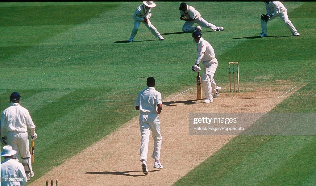 England batsman Michael Vaughan is dropped by Sri Lanka captain Sanath Jayasuriya at first slip off Nuwan Zoysa during the 1st Test between England...