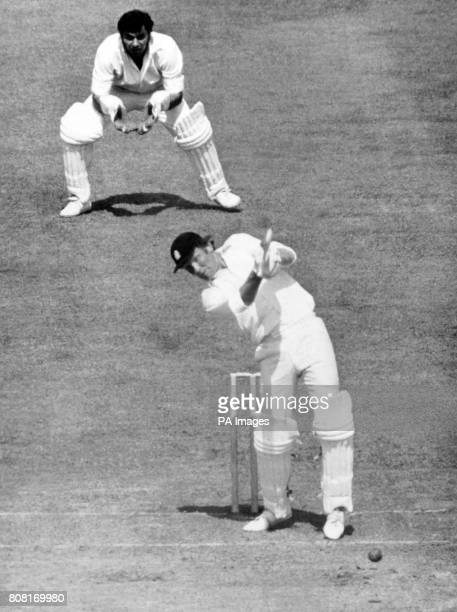 England batsman Mike Denness stikes the ball as India wicketkeeper Farokh Engineer is poised for action